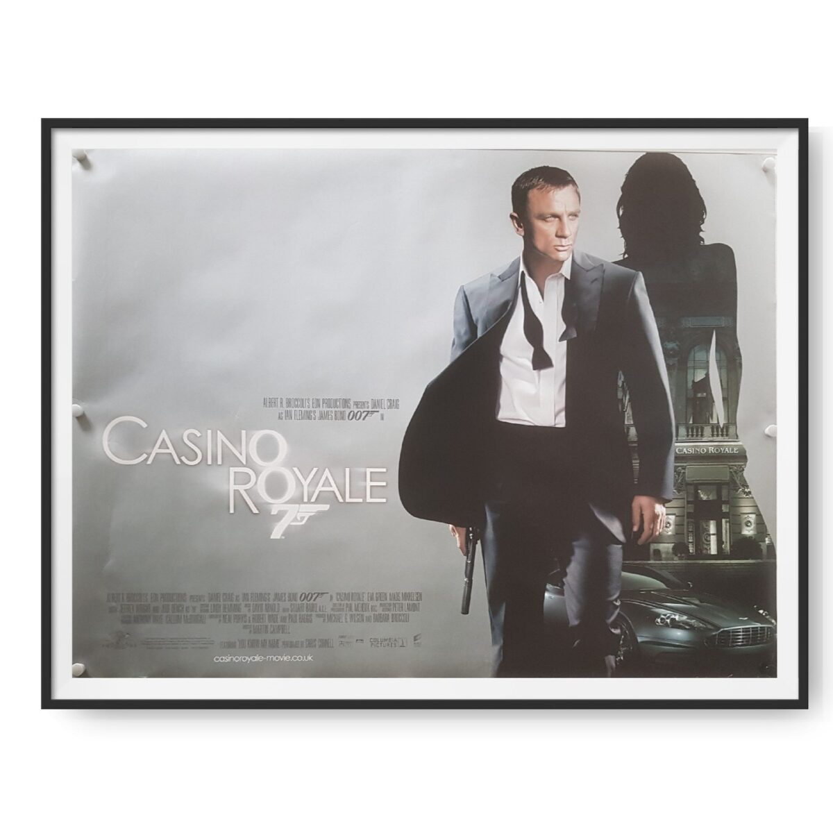 This UK film poster for the film Casino Royale show Daniel Craig as Bond in front of a grey background.