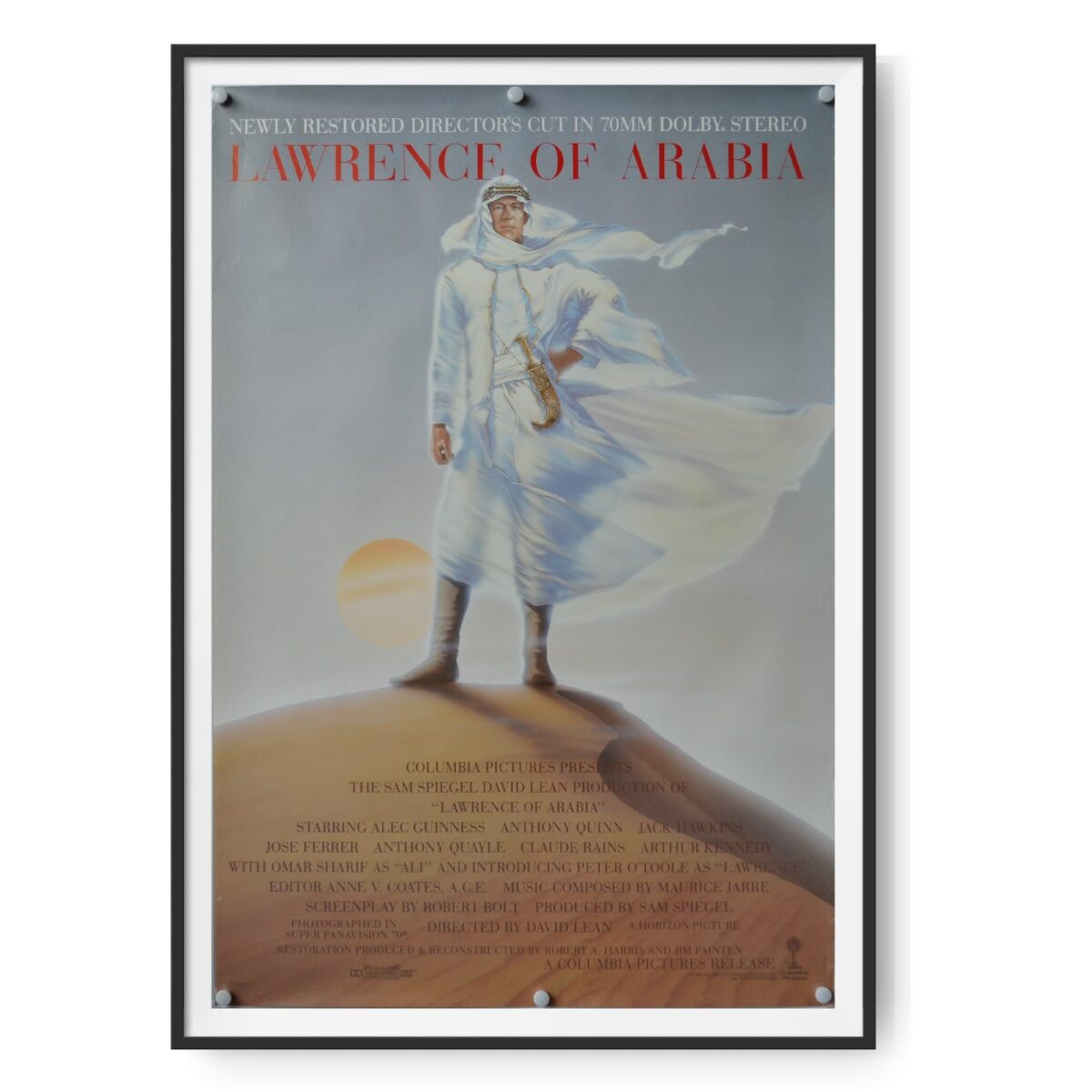 This US poster for Lawrence of Arabia show's the films hero in Bedouin clothes standing on a sand dune.
