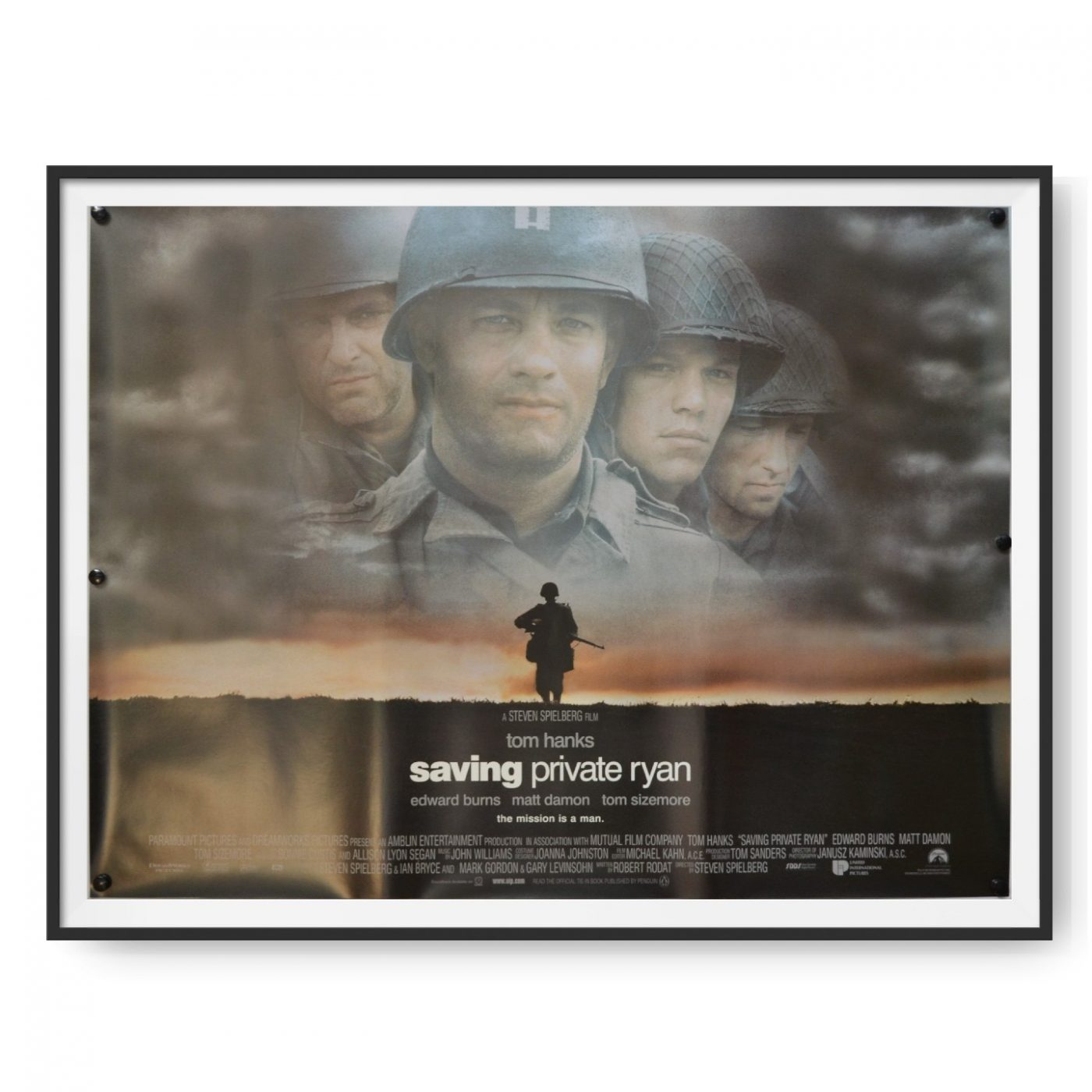 This is UK quad cinema poster for the film Saving Private Ryan. Tom Hanks and Matt Damon can be seen in the image.