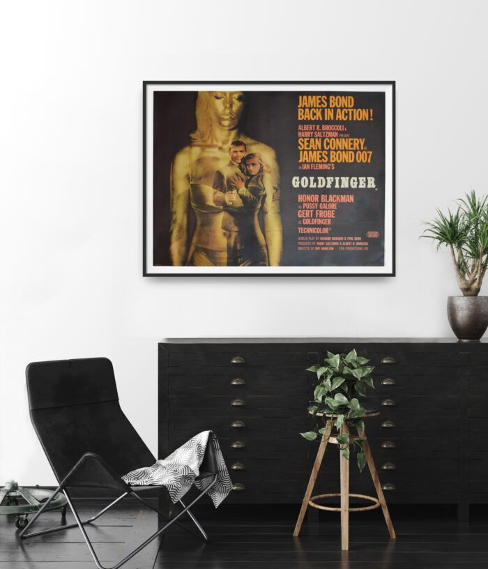 Original UK Quad Poster for the film Goldfinger. Poster is framed and in a room setting.