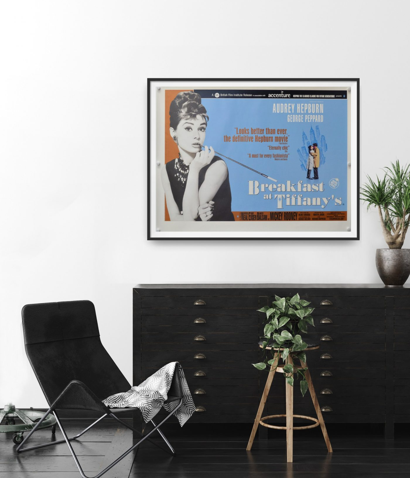 This is an original UK quad poster for a 2001 rerelease of Breakfast at Tiffany's. Audrey Hepburn features prominently in the image.