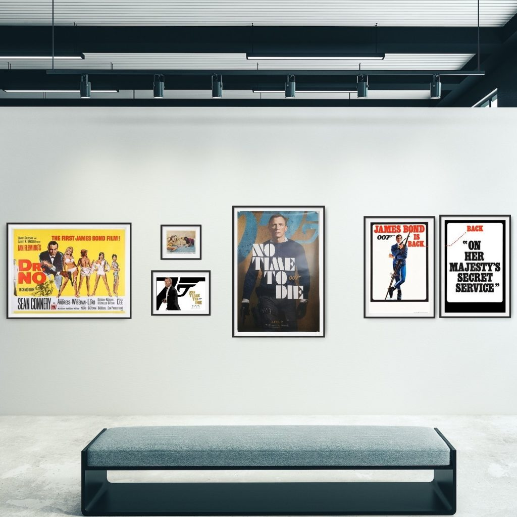 Gallery wall showing from left to right a 'Dr. No' Quad Poster, A 'Dr. No' Front of House Card, a 'No Time to Die' Mini Quad, a 'No Time to Die' UK One Sheet Poster and a set of 'On her Majesty's Secret Service Double Crown posters.