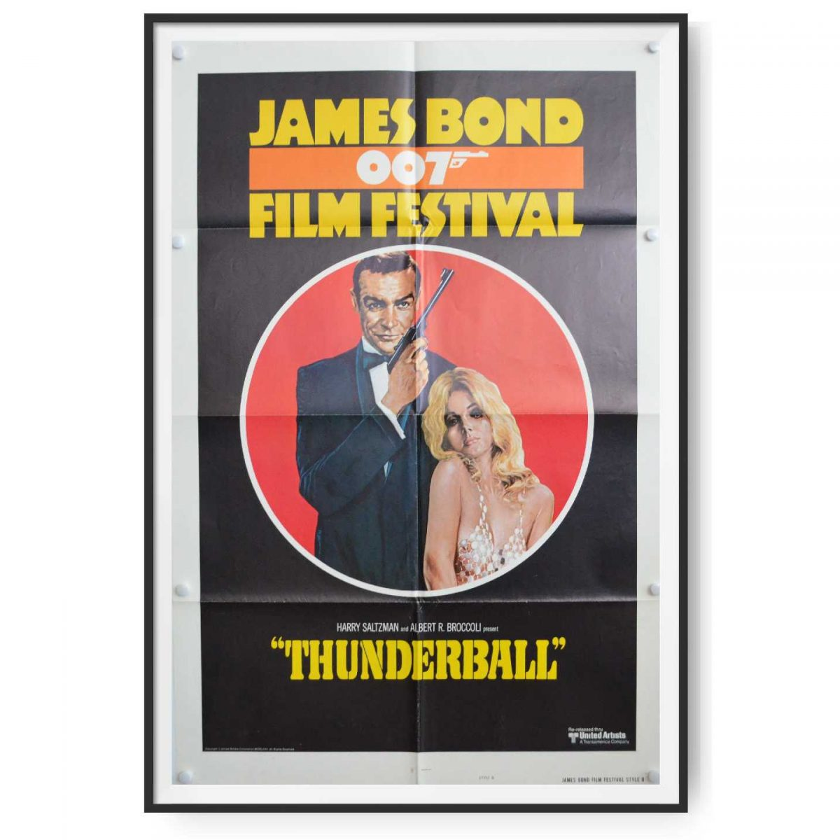 This poster shows Sean Connery as James Bond holding gun with silencer.