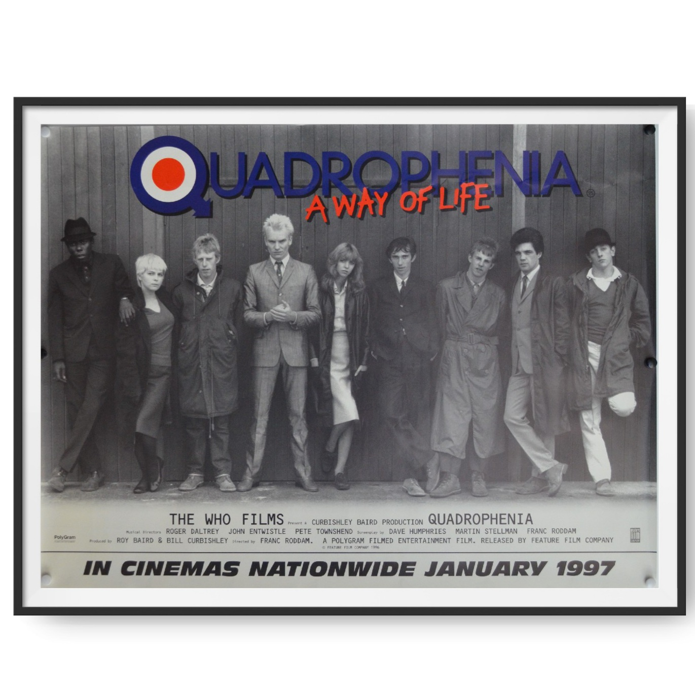 This is an original cinema poster for a 1997 re-release of the film Quadrophenia. The posters shows a group of the films characters, including Phil Daniels, Ray Winstone and Sting, standing in a line up.