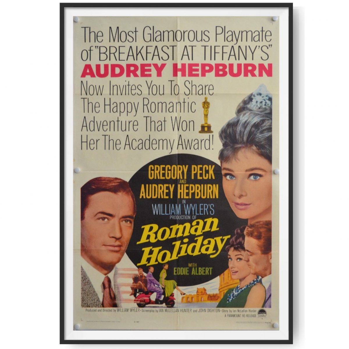 This is a framed US cinema poster for the film Roman Holiday. Audrey Hepburn and Gregory Peck features in the posters image.