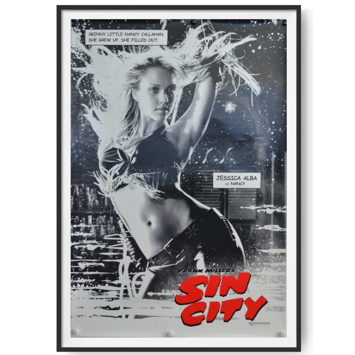 This is a framed US One Sheet Cinema Poster for the film Sin City. The image in the poster shows the character of Nancy played by Jessica Alba.