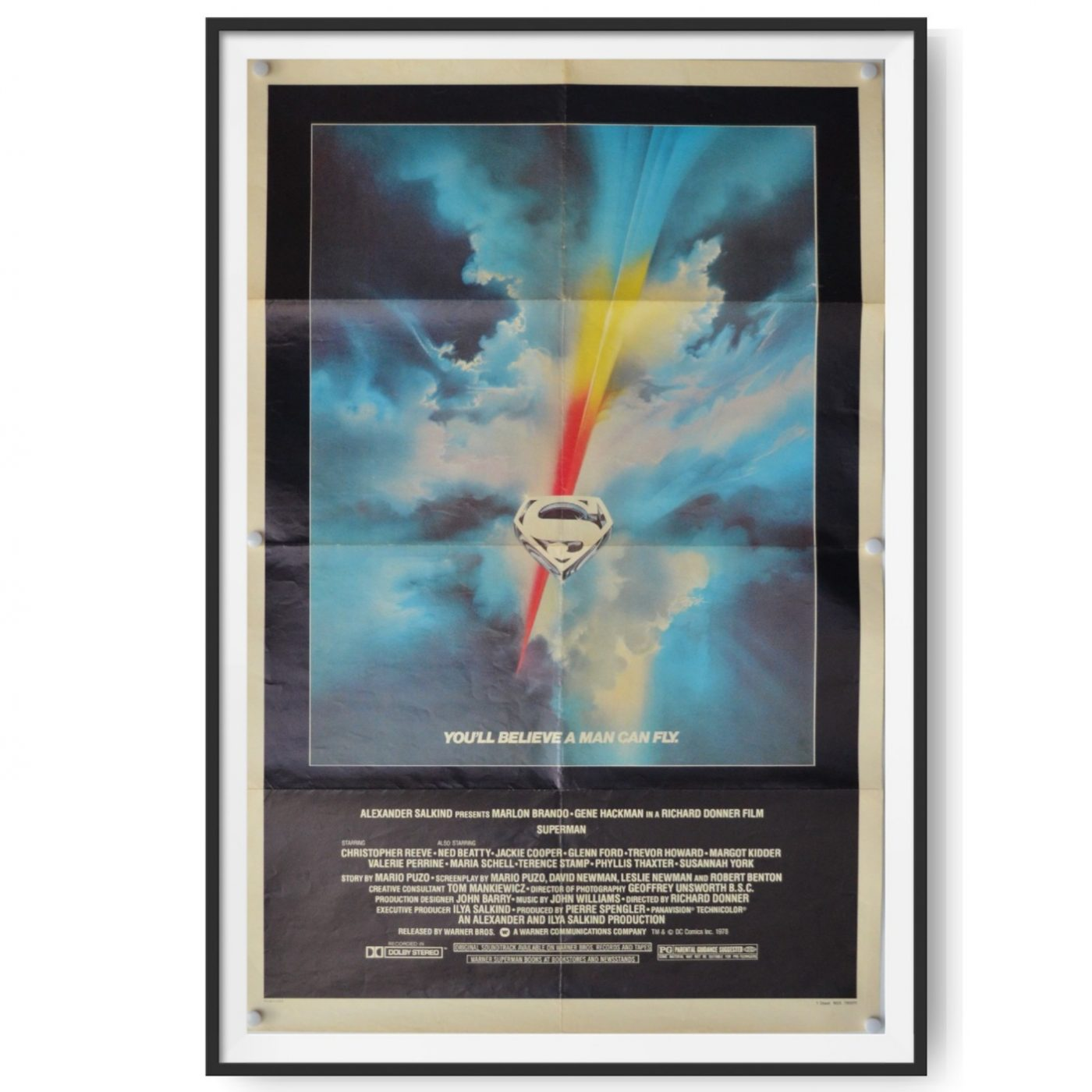 This is an original US One Sheet poster for the first release of the film Superman. The minimal poster design is by Bob Peak and features the famous 'Man of Steel' logo.