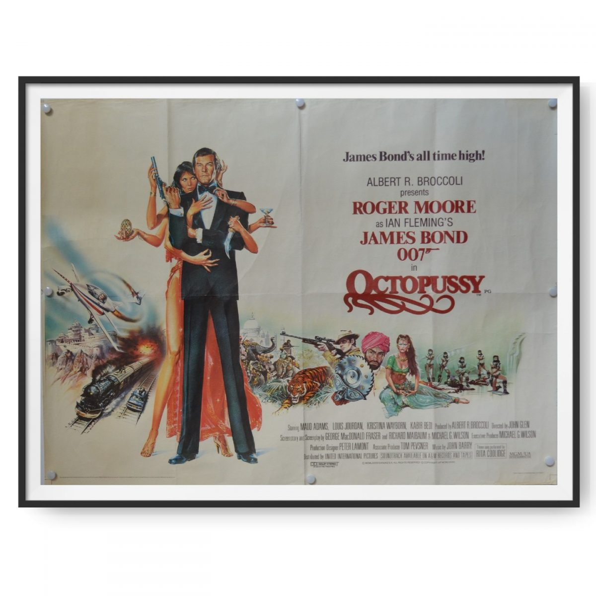 This is a UK Quad Poster for the James Bond film Octopussy. Roger Moore plays James Bond and can be seen on the poster with Maud Adams.