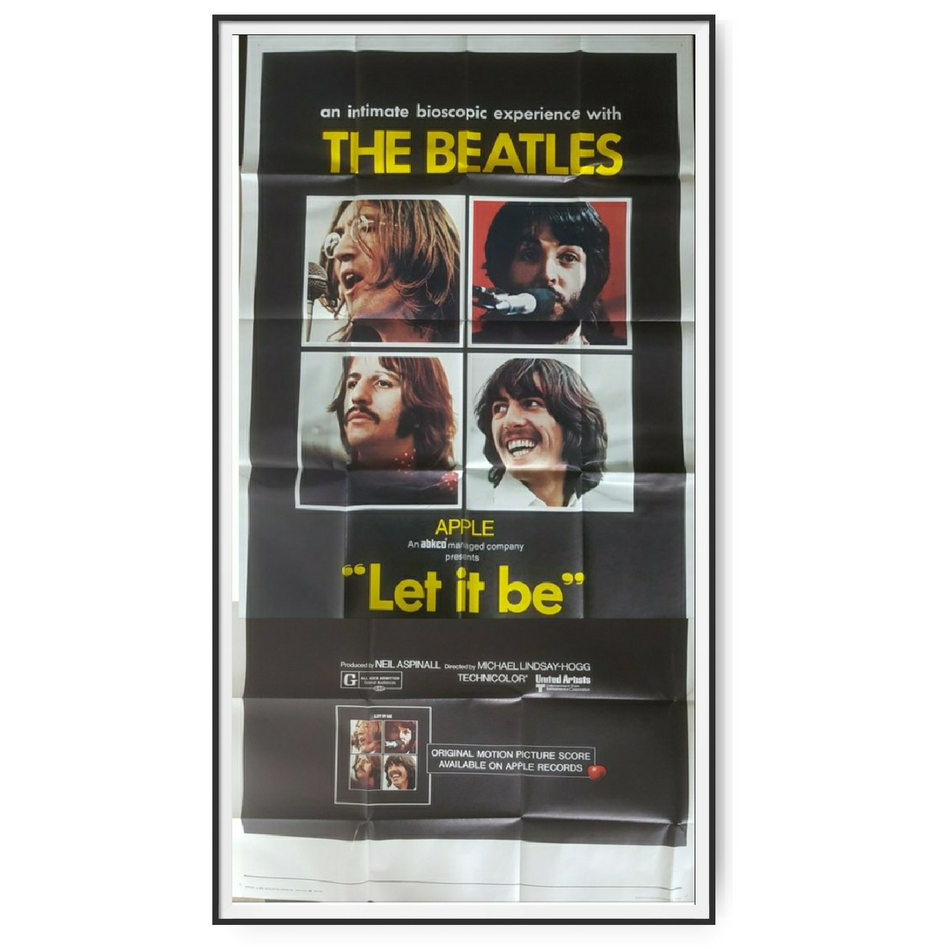 This cinema poster for the film Let It Be shows all 4 members of The Beatles.