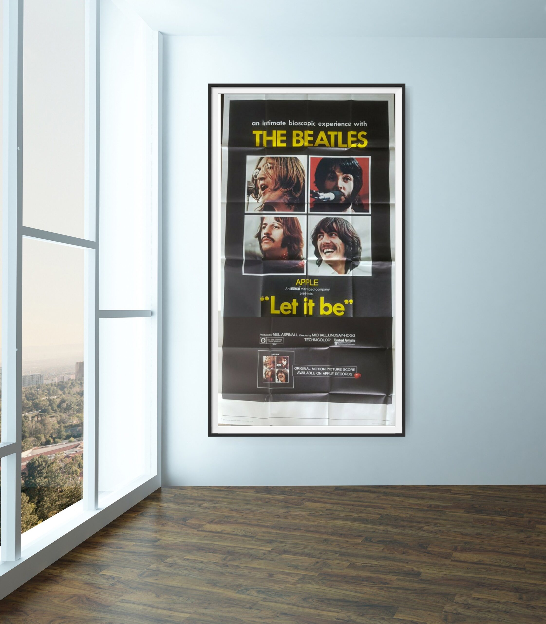 This film poster for Le It Be shows all 4 members of The Beatles.